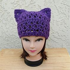 Dark Purple Handmade Crochet Lacy Lightweight Cotton Womens Pussy Cat Hat   Soft 100% cotton solid dark purple summer lightweight hat with cat ears. I used a high quality 100% cotton yarn thats a great alternative for anyone irritated by man-made fibers.   The color is called Black Currant, a basic solid dark purple. This yarn is matte (no sheen).   As the weather begins to warm up, I thought it would be a good idea to have some thinner cat hat options in addition to the warm winter ones…