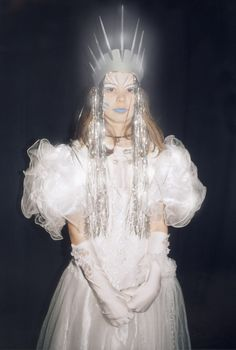Tess playing the Ice Queen in a school musical in 2005. I made the crown and did the make-up. The highlights are from Photoshop.