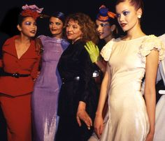 Fashion designer Tanya Sarne (center, in black) poses with models after a show by designer label Ghost in April 1995 at the Oyster Bar in New York's Grand Central Terminal.