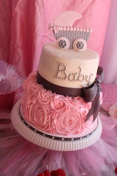 Wow, what an adorable baby shower cake! See more party ideas at CatchMyParty.com. #babyshower #cake #rosette