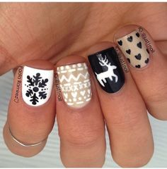 Nude, black and white nails with snowflakes, moose, and Indian print #holidaynails