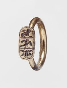 Etruscan, Ring with winged lion, siren, and flying scarab beetle, late 6th - early 5th century BC (source).