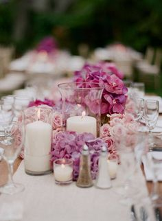 I like the idea of a low centre piece infused with candles to light up the table