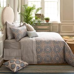 Madura Neela Bed - This was one of John's first fabric line prints, and it has become one of our most popular beds. Clover-shaped motifs in Paris blue are accented by floral line work in Hidustan brown.