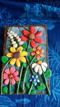 Pebble Art Driftwood Art Pebble Collage Wall Decor Pebble - A Unique Pebble Collage Hand Painted Beach Pebble Flowers The Stems Are Small Pieces Of Painted Driftwood All Of This Is Securely Glued To A Piece Of Reclaimed Wood With A Partially Painted Blue Pebble Painting, Pebble Art, Stone Painting, Pebble Beach, Pebble Stone, Body Painting, Stone Crafts, Rock Crafts, Arts And Crafts