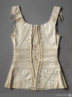 Corset, c. 1830, item number NMA.0044063  http://www.digitaltmuseum.se/things/snrliv-frn-1800-talets-frsta-hlft-nordiska/S-NM/NMA.0044063?name=Kl%C3%A4der+:+Underkl%C3%A4der&search_context=1&count=25&pos=7