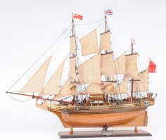 This is a museum-quality, fully assembled replica of H.M.S. Bounty, the 18th century British ship made famous in the movie 'Mutiny on the Bounty.' This beautiful H.M.S. Bounty model features: two tone