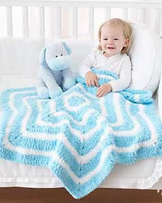 Beautiful blanket featuring a star-shaped stripe pattern, appropriate for any age of baby or child. Shown in Bernat Pipsqueak. (Bernat.com)