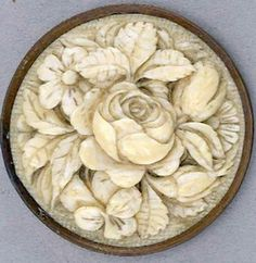 A beautiful 19th century carved ivory button. A large, carved rose and unopened…