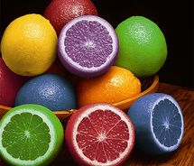 Inject food coloring in lemons- serve with water or in dishes to fit color theme of event {So doing this for a party!}
