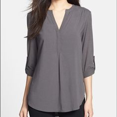 Nordstrom Tunic Top NWOT NWOT! A split-neck tunic in gray relaxed with roll-tab sleeves gets a trendy update from mixed-media styling that pairs a polished woven front with soft stretch-knit sleeves and back. Purchased at Nordstrom recently. Pleione Tops Tunics