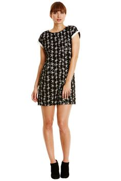 Black short tunic with dancing stars print in 100% organic certified cotton. Contrast cuffs.  Also available in pink and beige checked. Length 87cm.