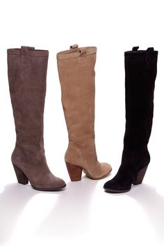 Soft suede and slouchy knee-high boots with a rounded toe, stacked heel and pull on tabs