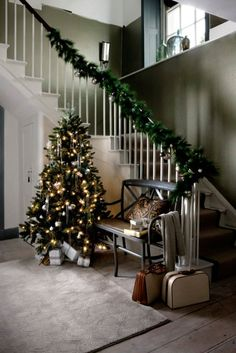 A faux fir garland and shades of green create a timeless and traditional Christmas look. Homes & Gardens December 2011. Photographer Paul Reaside.