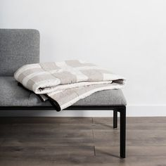Blurring the line between form and function, this graphic throw quilt is equally at home draped on a sofa or hung on the wall as a work of art.