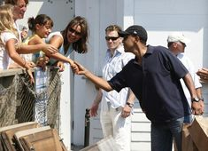 President Barack Obama shakes hands as he gets lunch at Nancy's while on vacation on Martha's Vineyard in Oak Bluffs, Mass. Wednesday, Aug. 26, 2009