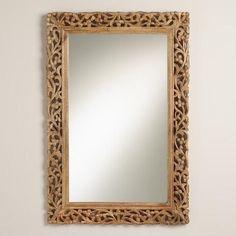 Wood framed ornate mirror