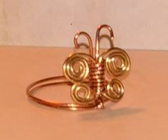 How to make a butterfly ring out of wire. Instructables.