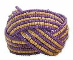 """ZAD Purple Seed Bead Braided Cuff Bracelet with Wood Beads ZAD by Ks Charming Designs. $11.00. Features Seed and Wood Beads. Cuff Adjusts from 2"""" so will open to fit your wrist. Comes in Gift Packaging by Ks Charming Designs. Unique Braided Cuff. Measures 2"""" Wide. Save 67% Off!"""
