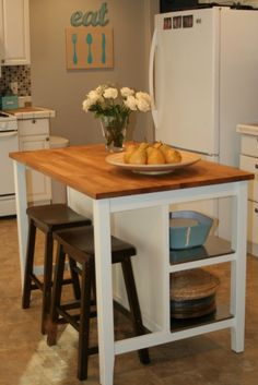 I want to take an old, antique dresser and make it into a kitchen island. It would be cool to put a counter on it that's oversized and then add stools!