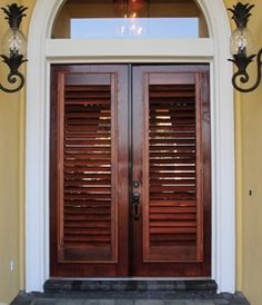 Exterior shutter doors for front door with solid glass backing for just enough privacy. Different and nice.