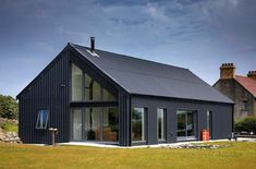 Low cost energy efficient rectangular design Ken Gill's rectangular design is low cost and energy efficient. House size: Plot size: acres Total project cost: SAP (EPC): 85 (B) Airtightness: Read full story via the link on our bio Home Building Design, Metal Building Homes, Building A House, Modern Barn House, Barn House Plans, Derelict House, Low Cost Housing, House Cladding, Shed Homes