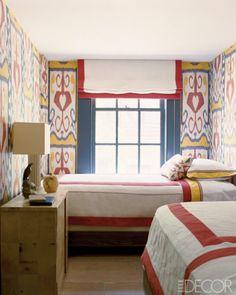 Steven Gambrel's guest bedroom walls are covered in vintage Ikat.
