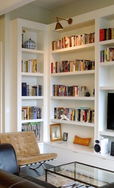 29 Cool Built-In Bookshelves Ideas For Your Home : 29 Cool Built In Bookshelves Ideas With White Wooden Bookshelves And Brown Sofa And Glass...
