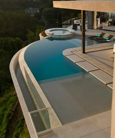 "Blue Jay Residence located just above the Sunset Strip in one of the prestigious ""Bird Streets"" of Hollywood Hills in Los Angeles.  Walls of glass in every room open to patios and balconies throughout and out to sensational views from Downtown to the Ocean.  4 bedrooms, 5.5 bathrooms on sale for just under thirteen million is described as ""a masterpiece, an unparalleled statement of vision and design."""