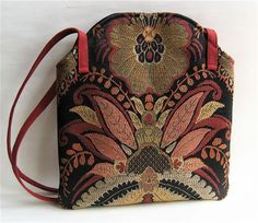 This beautiful tapestry fabric inspired the design for this small bag that is made from home decor fabric. The bag is lined with a black ottoman fabric, has one inside pocket and closes with a...