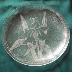 Iris flower, Hand engraved on glass Dish, Floral ornaments dish, Housewarming gift, Wedding personalized gift, New home gift, Couple gift    For that dish my inspiration was a story about Iris flower:  The Gods held a party for all the flowers. They all came bedecked in their finest colors. But one poor little flower - the Cinderella of the Flower Kingdom - appeared wearing only the dull, tattered dress of a cinder girl. And the heart of Iris was touched. She told the poor little flower…