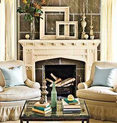 Timeless Appeal: This living room is decorated with casual pieces that complement its formal architecture. The neutral palette -- accented with soft blue pillows and accessories -- has the timeless appeal of a sepia-toned photograph. Please visit us at http://www.freecycleusa.com for awesome Green things for your home.