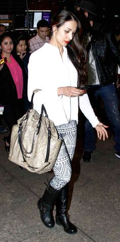 Malaika Arora Khan looked stylish in her simple white top and trendy printed black-and-white pants at Mumbai airport