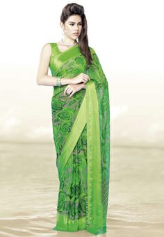 Brown and green faux chiffon saree designed with floral print. Available with neon green blouse fabric which can be customized from 34 to 44 inches, blouse shown in the image is just for photography purpose. (Slight variation in color, jacquard design and print design is possible.) data-pin-do=