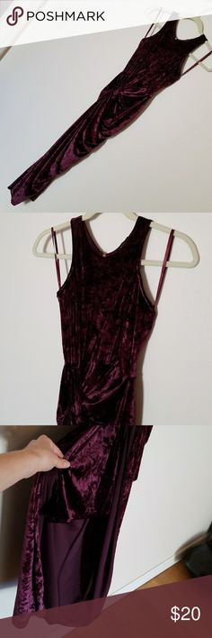 Burgundy Velvet Cocktail/Formal Dress Gorgeous and fits perfectly, stretchy fit but maintains shape. True to size. Mid high neckline adds style and class. Knotted at hip, then has a split from knot to bottom. Skirt underneath (as seen in pic) so don't be afraid to show off that leg! Length is below knee or mid calf depending on how tall you are. revamped Dresses Asymmetrical