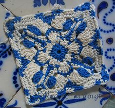 This is a beautiful crochet square. Go to ravelry and see them all put together in a blanket --- simply put, it's mesmerizing. I think of this square as a cross between Moroccan design and delft pottery. Link: http://www.ravelry.com/patterns/library/aveiro-azulejos-square