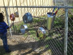 """Make a """"bang wall"""" with thrift store pots and pans for your kids to make music with outside.  SO doing this."""