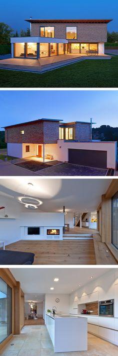 Einfamilienhaus modern mit Garage & Pultdach Architektur - Architektenhaus bauen mit Holz Fassade und Kamin - Design Haus Bullinger von Baufritz - HausbauDirekt.de