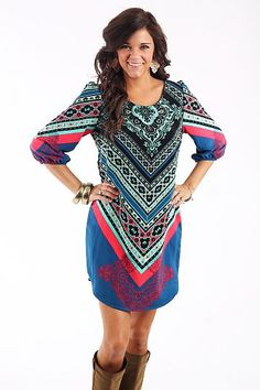 """The Salma Tunic, Blue $42.00 OMG we cannot get over the adorable handkerchief pattern this dress features! The colors are gorgeous and you can easily pair brown boots with this one:)   Fits true to size. Miranda is wearing the small.    From the shoulder to the hem:  S-33""""  M-34""""  L-34.5"""""""