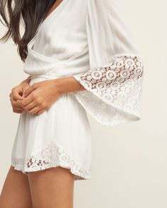 Supersoft and pretty wrap-front romper with lace panel detailing and keyhole at back.