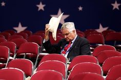 Tom Pauken, Republican Delegate of Texas takes off his hat before the start of the first day of the Republican National Convention