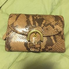 Coach snakeskin wallet Beige and tan coach wallet good used condition. Small ink stain on inside Coach Bags Wallets