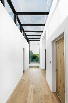 Double-height glazed circulation atrium runs through the middle of the house, linking the spaces together and creating a connection between front and rear.