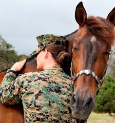 """"""" Operation Unbridled Freedom Hearts Therapeutic Equestrian Center honors US Veterans by offering the Operation Unbridled Freedom Program, designed for veterans by veterans. OUF offers an opportunity to build camaraderie; be of service to fellow veterans and the community; and experience a challenging physical activity."""" Photo Devon and Dezano embrace"""