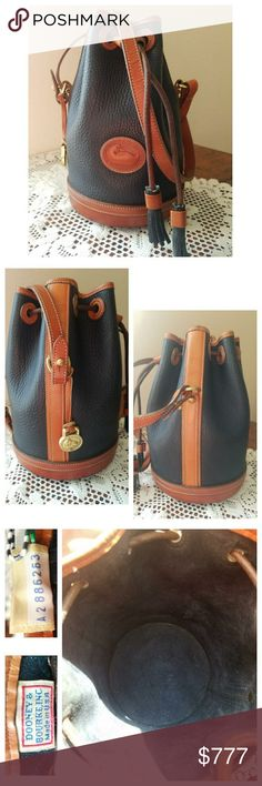 Vintage Dooney & Bourke AWL Drawstring This Navy & British Tan trim D&B All-Weather Leather R02 Drawstring is in very good vintage condition. Shows normal wear around the hand fitted leather encased wooden bottom, & the British tan trim around the top. Intact Dooney tag: Serial #A2886263. This is a vintage bag & does show wear on it; it is NOT a brand new bag, so please ▶L👀K◀ at all pictures. From my 🚬🆓🐶🐱🆓🏠. 〰N🚫 TRADES, N🚫 HOLDS, N🚫 LOWBALL OFFERS〰 Dooney & Bourke Bags Crossbody…