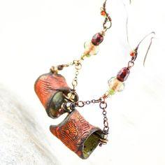 The Second Sin. Earrings. Signature tribal macaroni beads, crimson facted pearls, crystals, darkened chain, handmade Sterling Silver ear wires. #gaiacopia #artisanjewelry #earrings #etsy #handmade #polymerclay #metalsmith #boho #jewelery #gypsy #fashion #fashionista #instajewelry #inspiredlife #jewelrygram #souljewelry #rusticbling