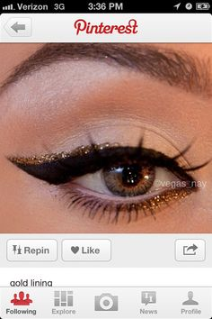 Looks like: Taupe shadow with bronzer highligh, white pencil on the waterline, black/brown gel pencil on lower lash line, fake lashes, black/brown liquid liner on top lashes, gold liquid or gel liner lining the last half of the black liner on top lid.