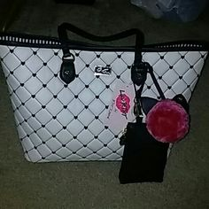 Betsey Johnson Purse/Tote Light cream an black.. With wallet an cute cat fuzzy ball... One zipper pocket an 2 open pockets on inside Betsey Johnson Bags Totes