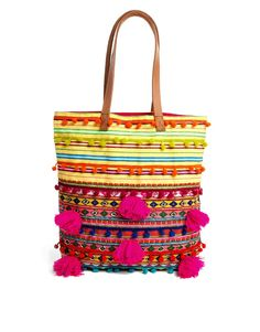 woven shopper with beads and pom poms - $65