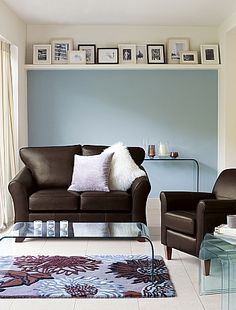 Arrange artwork on a shelf  Pictures don't always have to be hung on a wall. An arrangement of black and white family photos in box frames will look great sat on a chunky shelf. A simple interior design trick that is much easier than hanging individual pictures!